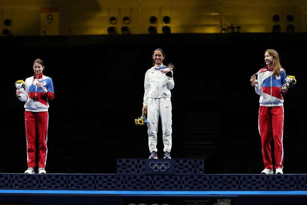 From left: Silver medalist Inna Deriglazova of Team ROC, gold medalist Lee Kiefer of Team United States and bronze medalist Larisa Korobeynikova of Team ROC pose on the podium during the medal ceremony for the Women's Foil Individual Fencing Gold Medal event on day two of the Tokyo 2020 Olympic Games at Makuhari Messe Hall on July 25, 2021, in Chiba, Japan.