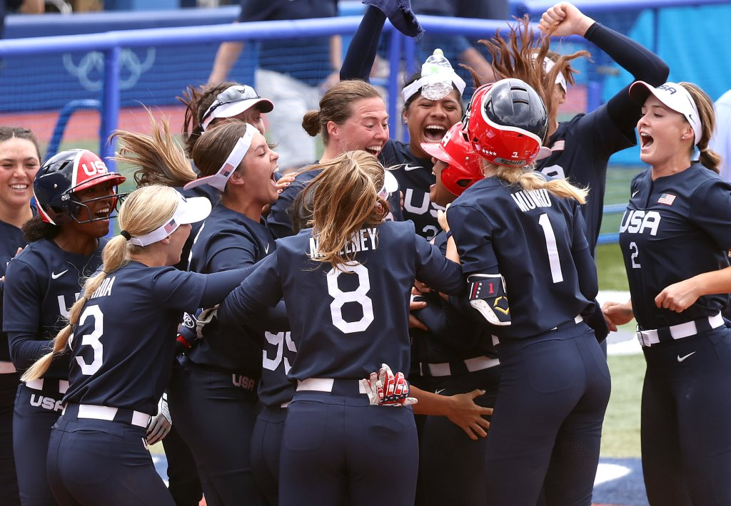 Team United States players celebrate with teammate Kelsey Stewart #7 after she hit a walk-off home run to win the game 2-1 against Team Japan during softball opening round on day three of the Tokyo 2020 Olympic Games at Yokohama Baseball Stadium on July 26, 2021 in Yokohama, Kanagawa, Japan.