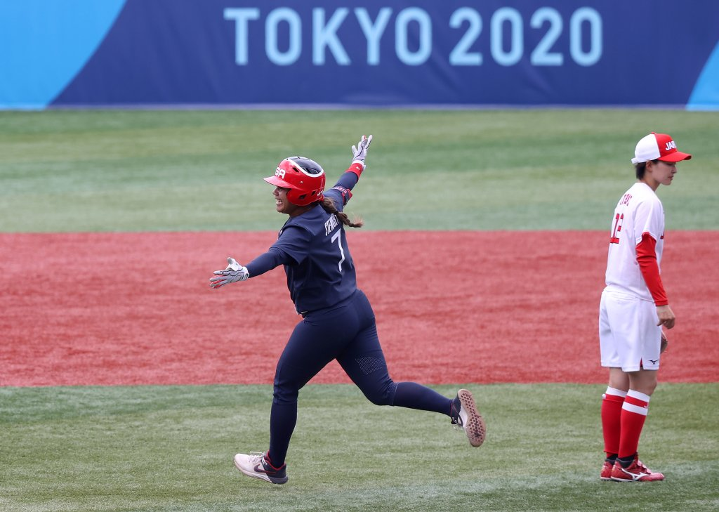 Kelsey Stewart #7 of Team United States celebrates while rounding second base after hitting a walk-off home run in the eighth inning as Mana Atsumi #12 of Team Japan looks on during softball opening round on day three of the Tokyo 2020 Olympic Games at Yokohama Baseball Stadium on July 26, 2021 in Yokohama, Kanagawa, Japan. Team United States defeated Team Japan 2-1.