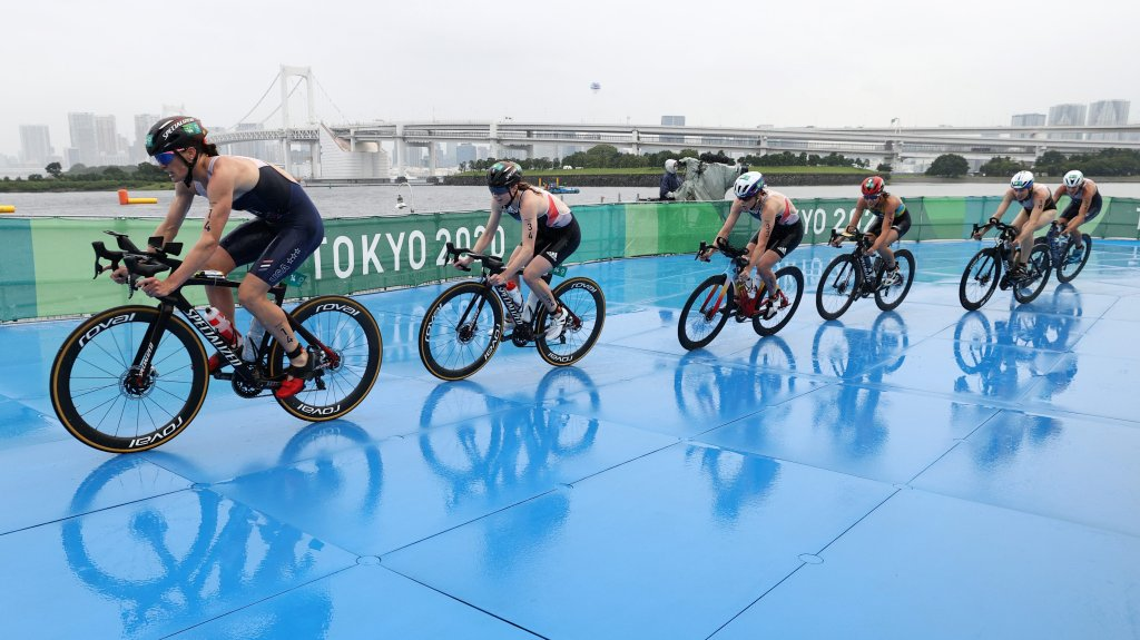 Katie Zaferes of Team United States rides ahead of Georgia Taylor-Brown of Team Great Britain, Jessica Learmonth of Team Great Britain, Vittoria Lopes of Team Brazil, Laura Lindemann of Team Germany and Summer Rappaport of Team United States during the Women's Individual Triathlon on day four of the Tokyo 2020 Olympic Games at Odaiba Marine Park on July 27, 2021, in Tokyo, Japan.