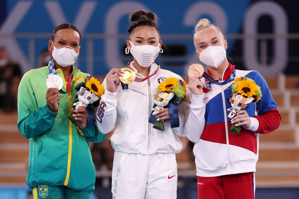 From left: Silver medalist Rebeca Andrade of Team Brazil, gold medalist Sunisa Lee of Team USA and bronze medalist Angelina Melnikova of Team ROC pose for a photo after the Women's All-Around Final on day six of the Tokyo 2020 Olympic Games at Ariake Gymnastics Centre on July 29, 2021 in Tokyo, Japan.