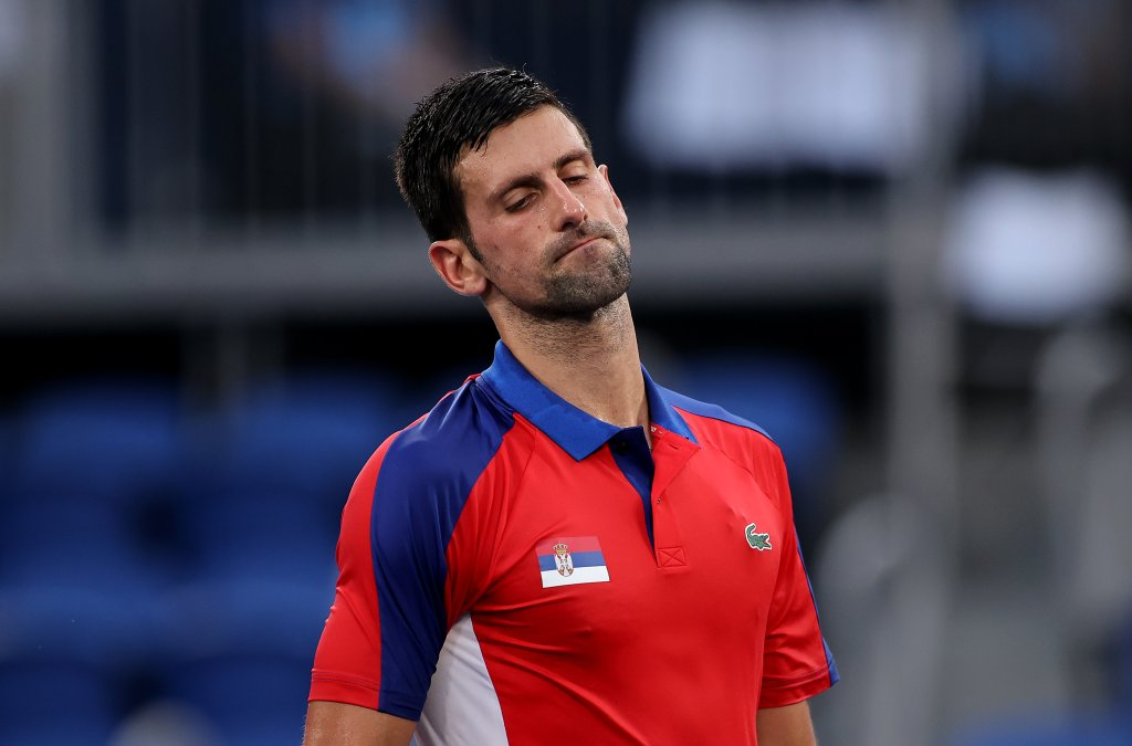 Novak Djokovic of Team Serbia reacts after a point during his Men's Singles Semifinal match against Alexander Zverev of Team Germany on day seven of the Tokyo 2020 Olympic Games at Ariake Tennis Park on July 30, 2021 in Tokyo, Japan.