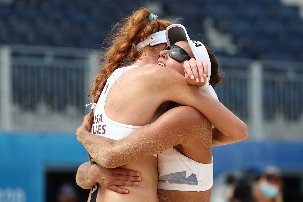 Kelly Claes #1 of Team United States celebrates with Sarah Sponcil #2 after defeating Team Brazil during the Women's Preliminary - Pool D beach volleyball on day eight of the Tokyo 2020 Olympic Games at Shiokaze Park on July 31, 2021, in Tokyo, Japan.