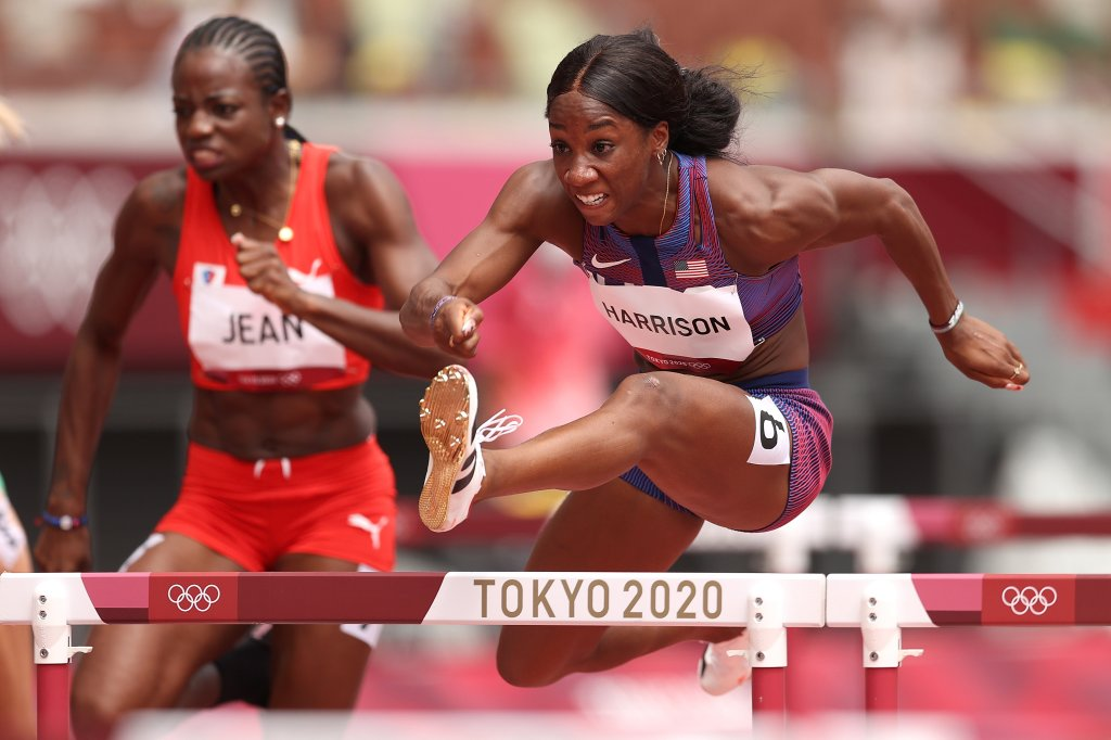 Mulern Jean of Team Haiti and Kendra Harrison of Team United States compete in round one of the women's 100m hurdles heats on day eight of the Tokyo 2020 Olympic Games at Olympic Stadium on July 31, 2021, in Tokyo, Japan.