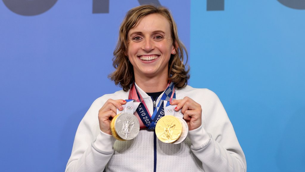 Katie Ledecky of Team USA holds up the four medals she won during the Tokyo Games, July 31, 2021 in Tokyo, Japan. Ledecky won two golds for her performance in the women's 800-meter and 1500-meter freestyle races, as well as two silvers for the 400-meter freestyle and 4x200 freestyle relay.