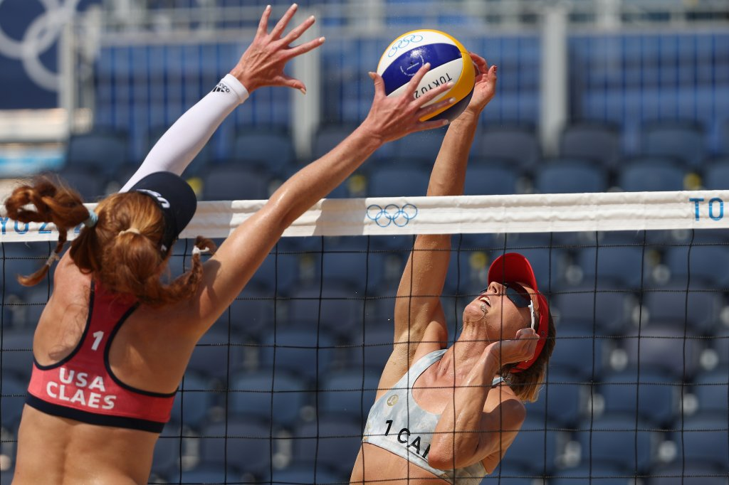 Kelly Claes #1 of Team United States attempts to block the hit by Heather Bansley #1 of Team Canada during the Women's Round of 16 beach volleyball on day nine of the Tokyo 2020 Olympic Games at Shiokaze Park on August 1, 2021, in Tokyo, Japan.