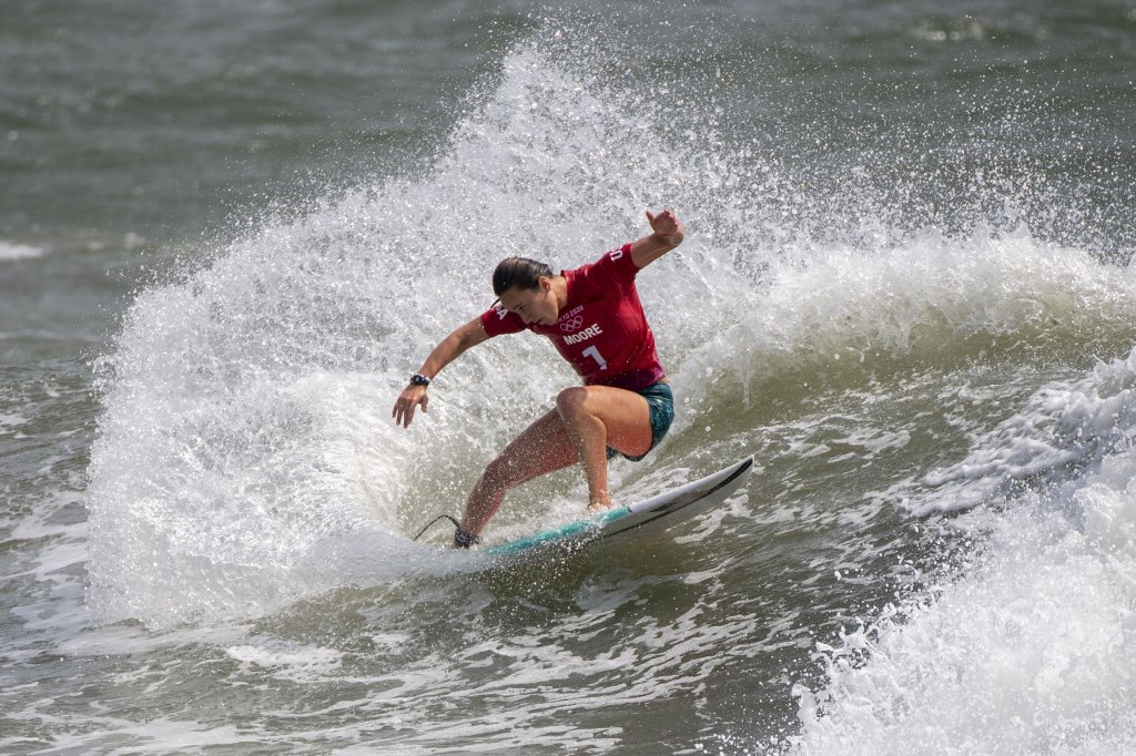 USA's Carissa Moore rides a wave during the women's Surfing Third round at the Tsurigasaki Surfing Beach, in Chiba, on July 26, 2021 during the Tokyo 2020 Olympic Games.
