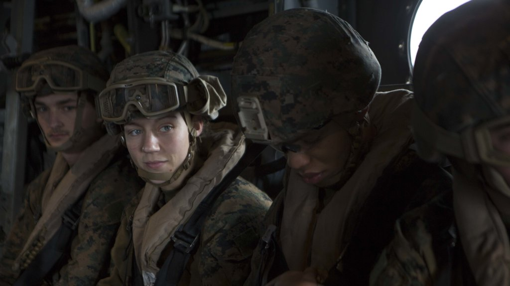 U.S. Marine Corps Corporal Nicole Gee (left middle), a maintenance technician with 24th Marine Expeditionary Unit (MEU), awaits the launch of an MV-22B Osprey during an en route care exercise aboard the Wasp-class amphibious assault ship USS Iwo Jima (LHD 7), April 5, 2021.