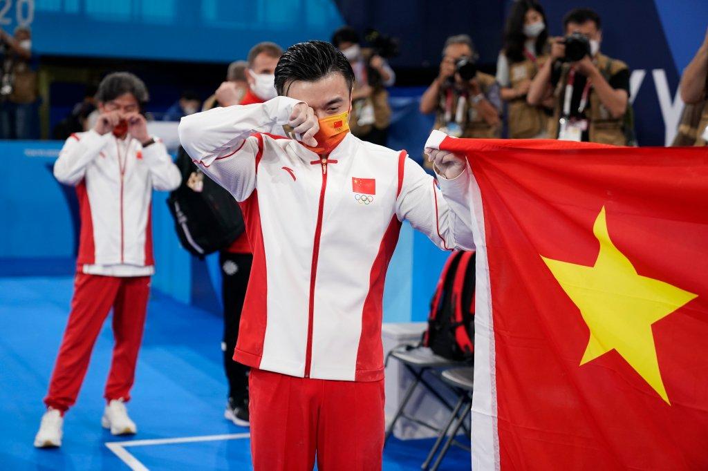 Liu Yang, of China, cries after winning gold