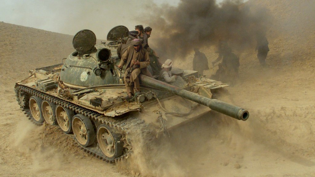 Defecting Taliban fighters maneuver a tank through the front line near the village of Amirabad, Nov. 24, 2001. Hundreds of Taliban defected to the northern alliance that day, paving the way for the fall of Kunduz.
