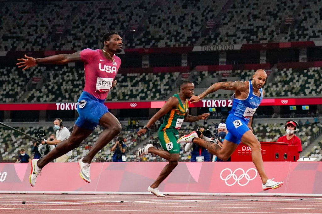 Lamont Jacobs of Italy, right, wins the men's the 100-meter final at the Tokyo Olympics, Sunday, Aug. 1, 2021, in Tokyo. Team USA's Fred Kerley, left, took home silver for the event.