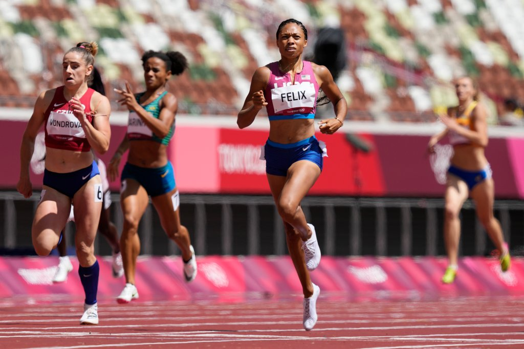 Allyson Felix, of United States races ahead of Lada Vondrova, of Czech Republic in a women's 400-meter heat at the 2020 Summer Olympics, Tuesday, Aug. 3, 2021, in Tokyo, Japan.