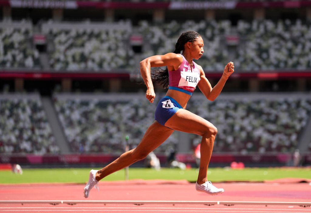 Allyson Felix, of United States races in a women's 400-meter heat at the 2020 Summer Olympics, Tuesday, Aug. 3, 2021, in Tokyo, Japan.