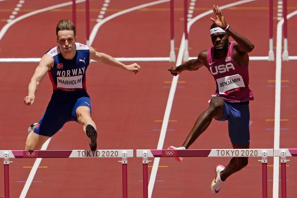 Karsten Warholm, of Norway, left, clears the final hurdle before winning the gold medal ahead of Rai Benjamin, of United States in the final of the Men's 400-Meter Hurdles at the 2020 Olympics, Tuesday, Aug. 3, 2021, in Tokyo, Japan.