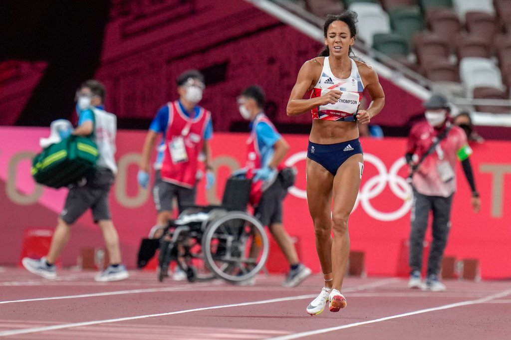 Katarina Johnson-Thompson, of Britain, finishes a heat of the heptathlon women's 200-meter at the Tokyo Olympics after falling from an injury, Wednesday, Aug. 4, 2021, in Tokyo. Johnson-Thompson, the defending world champion, refused a wheelchair and finished the heat on her injured leg.