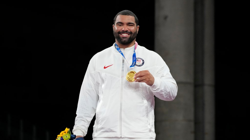 United States' Gable Dan Steveson celebrates with his gold medal during the victory ceremony for men's freestyle 125kg wrestling at the 2020 Summer Olympics, Friday, Aug. 6, 2021, in Chiba, Japan.