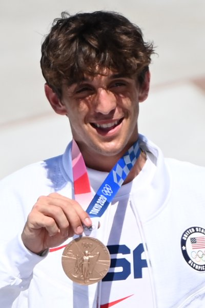 Cory Juneau posing with his bronze medal.