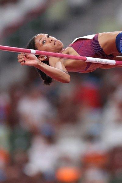 Vashti Cunningham performing a high jump.