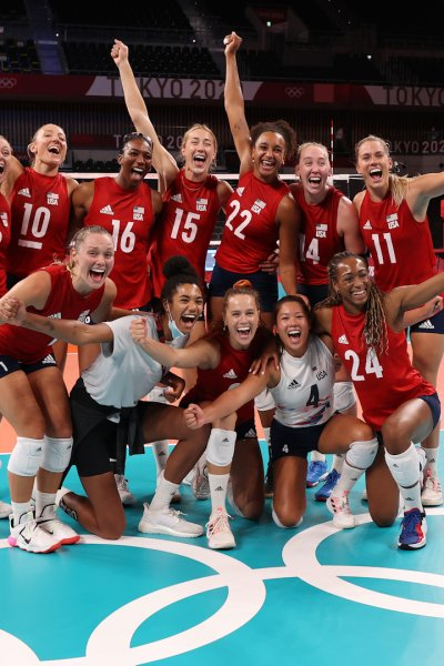Team USA women's volleyball celebrates after defeating Italy.