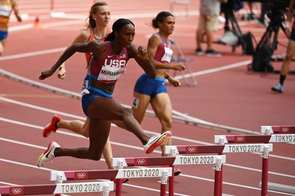 The United State's Dalilah Muhammad, Netherlands' Femke Bol and the United State's Sydney Mclaughlin compete in the women's 400m hurdles final during the Tokyo 2020 Olympic Games at the Olympic Stadium in Tokyo, Japan on Aug. 4, 2021.