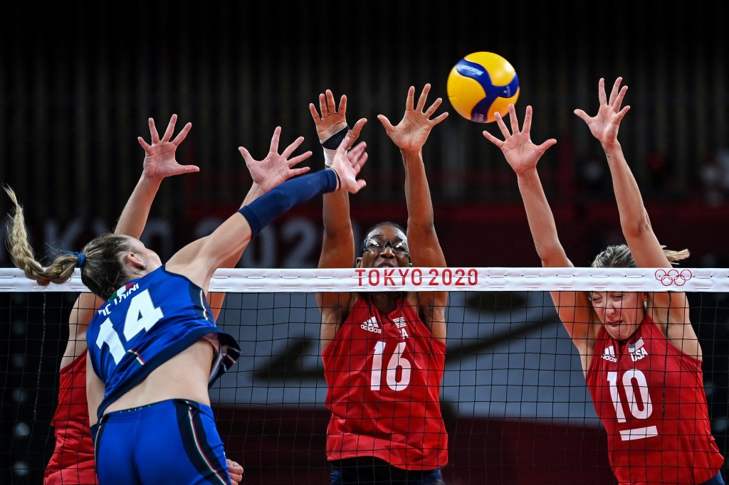 Italy's Elena Pietrini hits the ball in front of USA's Foluke Akinradewo and Jordan Larson in the women's preliminary round pool B volleyball match between USA and Italy during the Tokyo 2020 Olympic Games at Ariake Arena in Tokyo on Aug. 2, 2021.