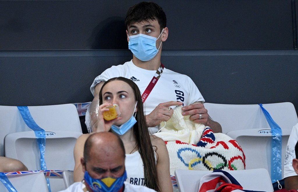 British diver Thomas Daley sits with his knitting as he watches divers