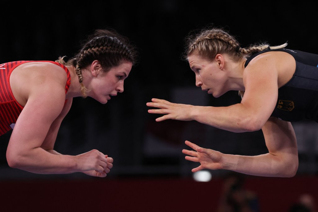 Germany's Aline Rotter Focken (blue) wrestles USA's Adeline Maria Gray in their women's freestyle 76kg wrestling final match during the Tokyo 2020 Olympic Games