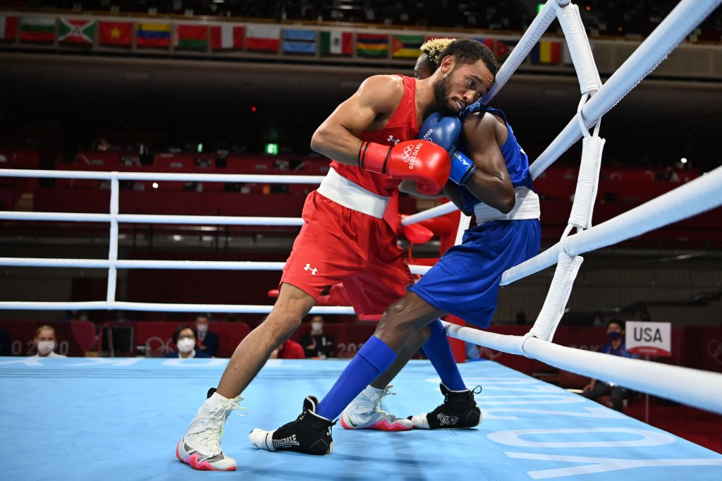 USA's Duke Ragan (red) and Ghana's Samuel Takyi fight during their men's feather (52-57kg) semi-final boxing match during the Tokyo 2020 Olympic Games at the Kokugikan Arena in Tokyo, Japan on Aug. 3, 2021.