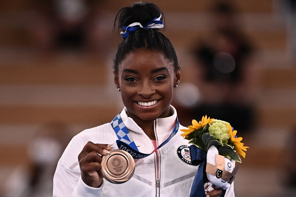 USA's Simone Biles poses with her bronze medal