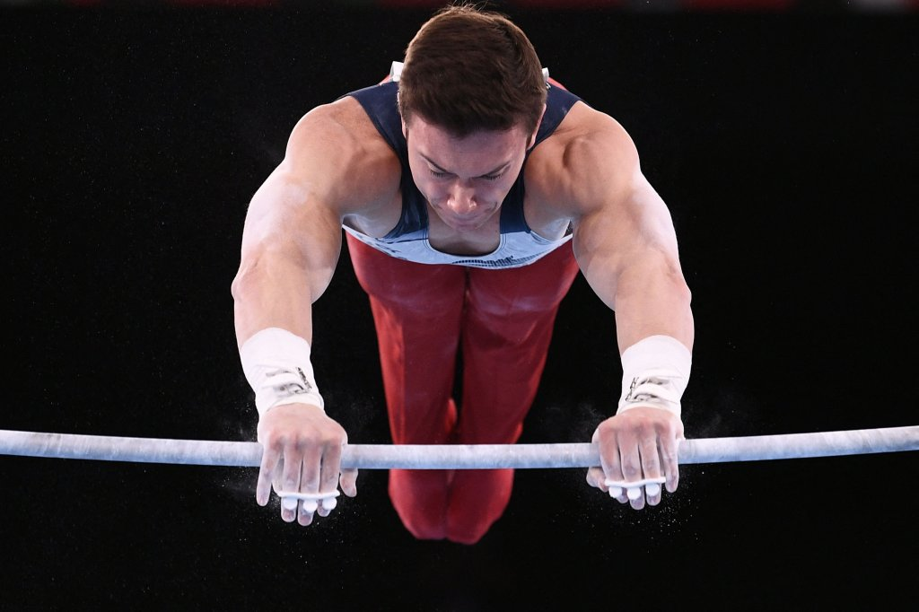 USA's Brody Malone competes in the artistic gymnastics men's horizontal bar final