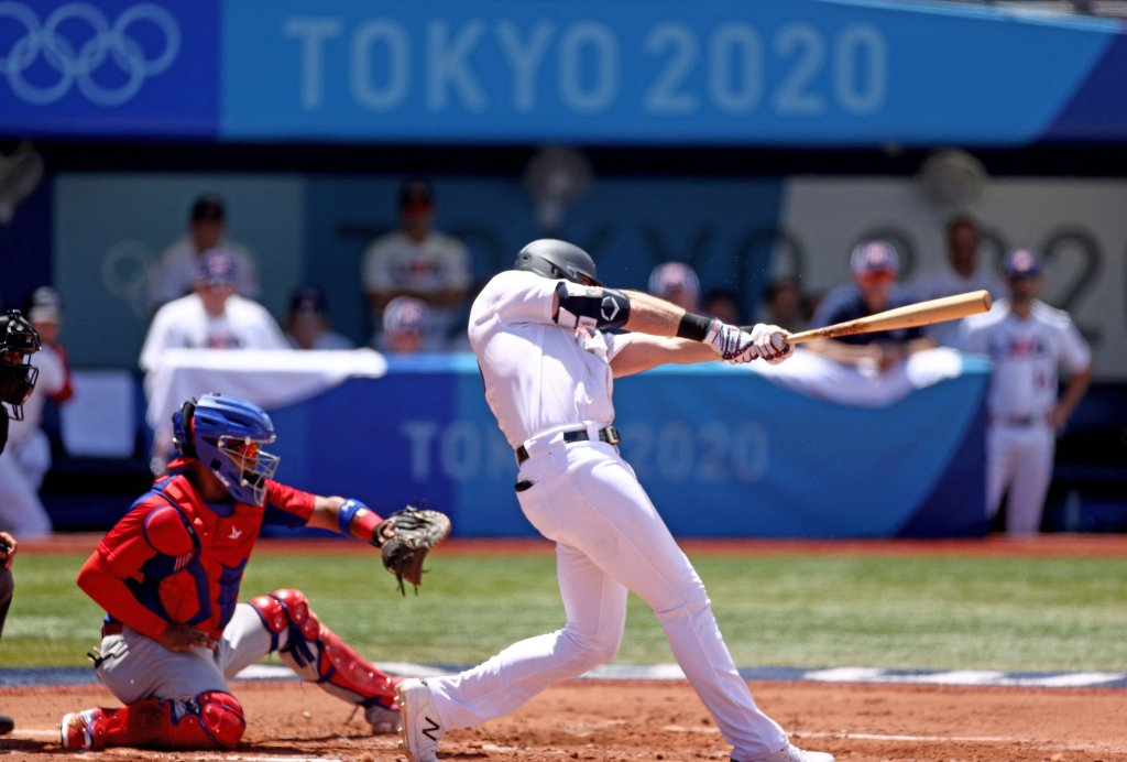 USA's Triston Casas (R) hits a two run home run during the first inning of the Tokyo 2020 Olympic Games baseball round 2 repechage game between Dominican Republic and USA at Yokohama Baseball Stadium in Yokohama, Japan, on Aug. 4, 2021.