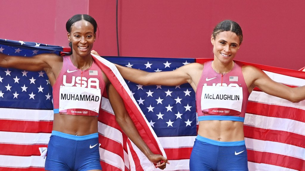 USA's Sydney Mclaughlin, right, celebrates her gold medal in the women's 400m hurdles. She sets a new world record with silver medalist USA's Dalilah Muhammad, left, during the Tokyo 2020 Olympic Games at the Olympic Stadium in Tokyo, Japan on Aug. 4, 2021.