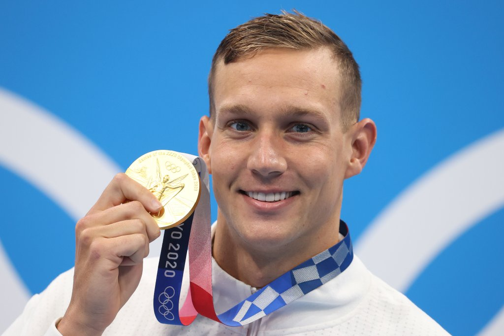 Gold medalist Caeleb Dressel of Team United States poses with the gold medal for the Men's 50m Freestyle Final on day nine of the Tokyo 2020 Olympic Games at Tokyo Aquatics Centre on August 1, 2021 in Tokyo, Japan.