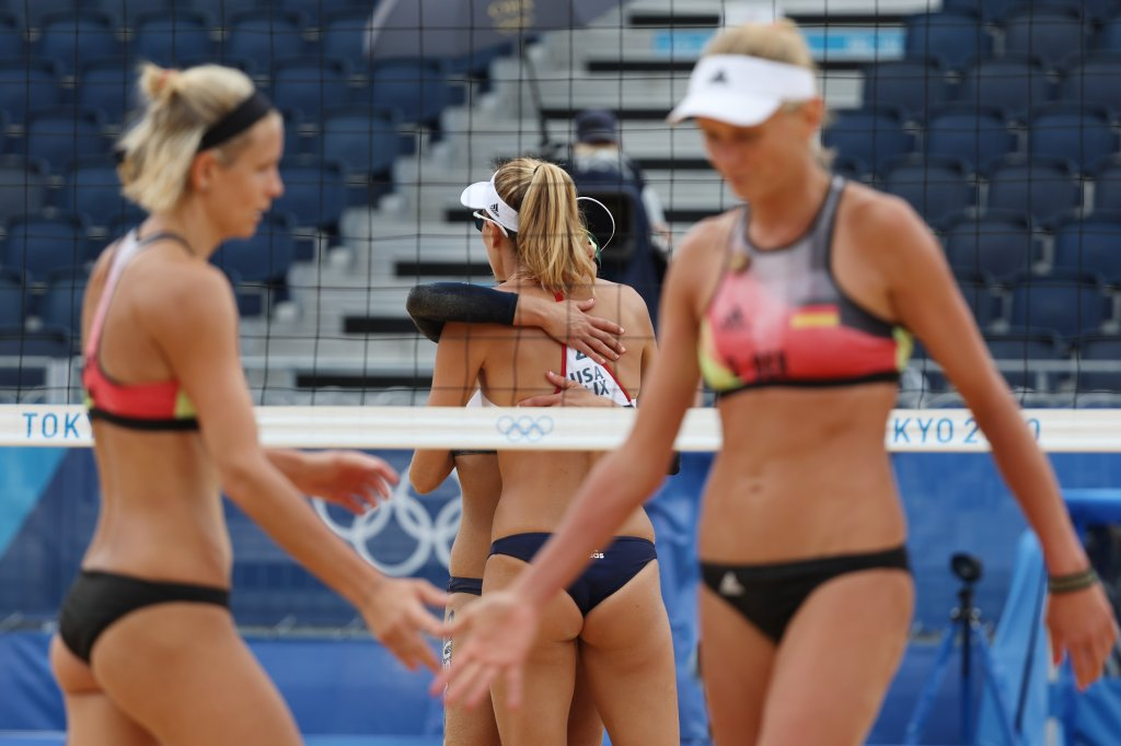 Alix Klineman #2 of Team United States celebrates with April Ross #1 against Team Germany during the Women's Quarterfinal beach volleyball on day eleven of the Tokyo 2020 Olympic Games at Shiokaze Park on August 03, 2021 in Tokyo, Japan.