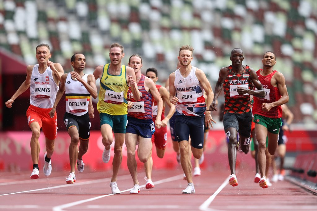 Michal Rozmys of Team Poland, Ismael Debjani of Team Belgium, Oliver Hoare of Team Australia, Cole Hocker of Team United States, Josh Kerr of Team Great Britain, Timothy Cheruiyot of Team Kenya and Abdelatif Sadiki of Team Morocco compete in round one of the Men's 1500m heats on day eleven of the Tokyo 2020 Olympic Games at Olympic Stadium on Aug. 3, 2021, in Tokyo, Japan.