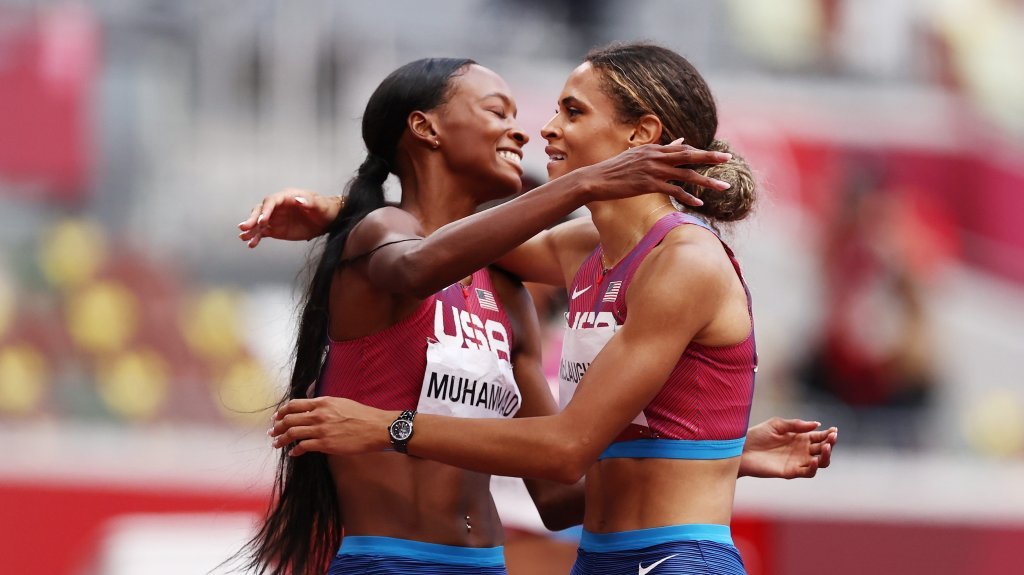 Silver medalist Dalilah Muhammad hugs gold medalist Sydney McLaughlin, both of Team United States, after competing in the Women's 400m Hurdles Final on day 12 of the Tokyo 2020 Olympic Games at Olympic Stadium on Aug. 4, 2021 in Tokyo, Japan.