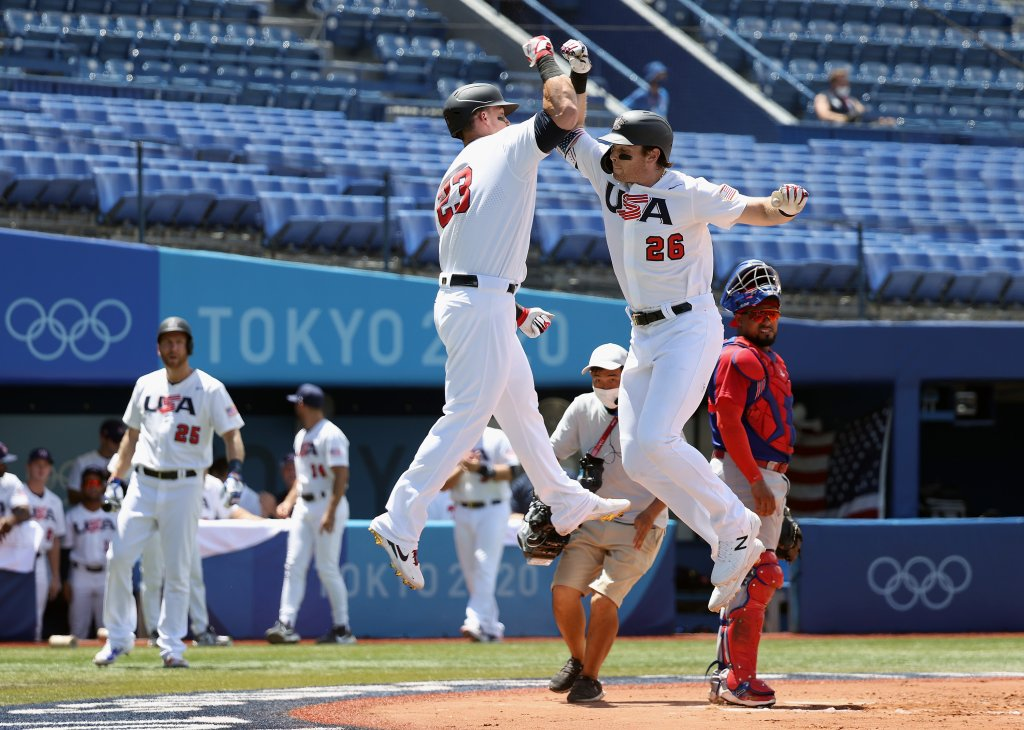 Triston Casas #26 and Tyler Austin #23 of Team United States celebrate Casas' two-run home run as catcher Charlie Valerio #7 Team Dominican Republic looks on in the first inning during the knockout stage of men's baseball on day twelve of the Tokyo 2020 Olympic Games at Yokohama Baseball Stadium on Aug. 4, 2021, in Yokohama, Japan.