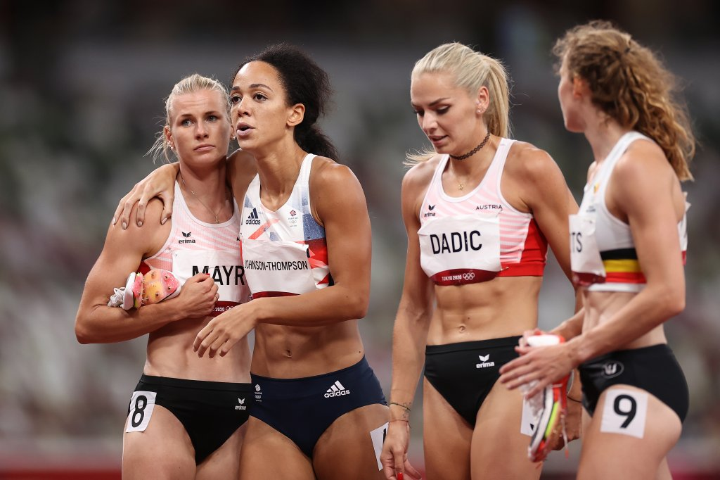 Katarina Johnson-Thompson of Team Great Britain is consoled by Verena Mayr of Team Austria as she walks off the track injured during the Women's Heptathlon 200m heats on day twelve of the Tokyo 2020 Olympic Games at Olympic Stadium on Aug.4, 2021 in Tokyo, Japan.