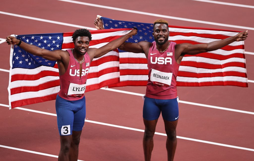 Bronze medal winner Noah Lyles and silver medal winner Kenneth Bednarek, both of Team USA, celebrate after the Men's 200m final on day twelve of the Tokyo Olympic Games at Olympic Stadium on Aug. 4, 2021, in Tokyo, Japan.