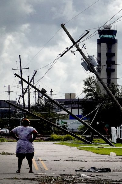 A woman looks over damage to a neighborhood caused by Hurricane Ida on Aug. 30, 2021 in Kenner, Louisiana.
