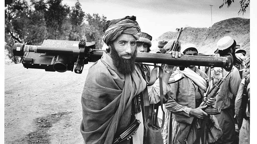 A mujahadeen fighter carries a U.S.-made shoulder-fired Stinger missile during the 1989 Jalalabad offensive in eastern Afghanistan. The weapon is capable of shooting down fast-moving aircraft by locking on to the heat signal generated by the engines.