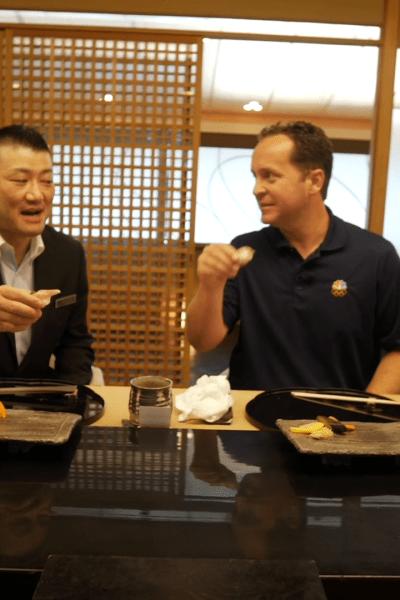Steve Luke eating sushi