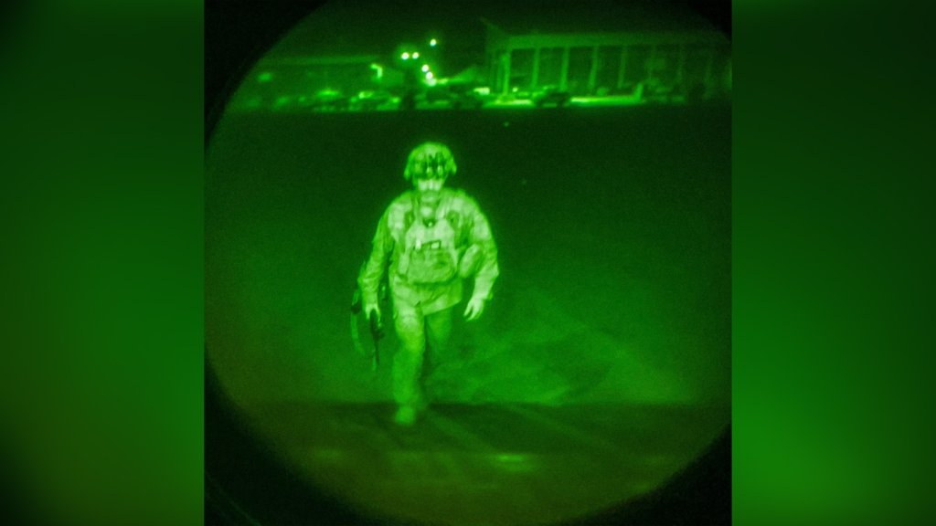 A picture of the last soldier to leave Afghanistan taken by the XVIII Airborne Corps.