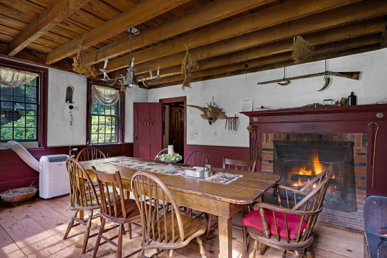 """The dining room inside 1677 Round Top Road in Burrillville, Rhode Island, which served as inspiration for """"The Conjuring."""" The house was last sold in 2019."""