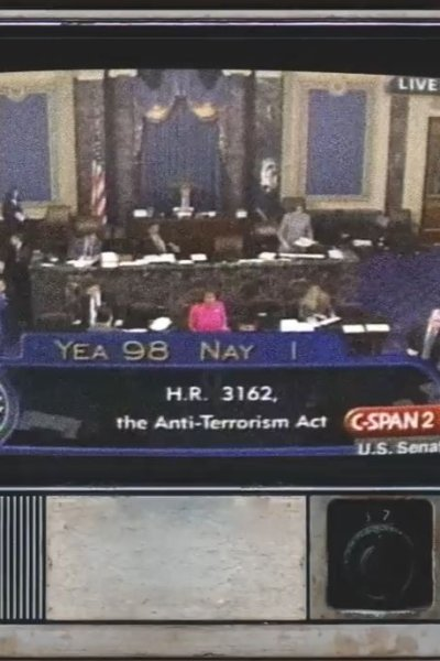 """Image of the U.S. Senate floor from CSPAN in 2001 with a graphic reading """"YEA 98 NAY 1"""""""